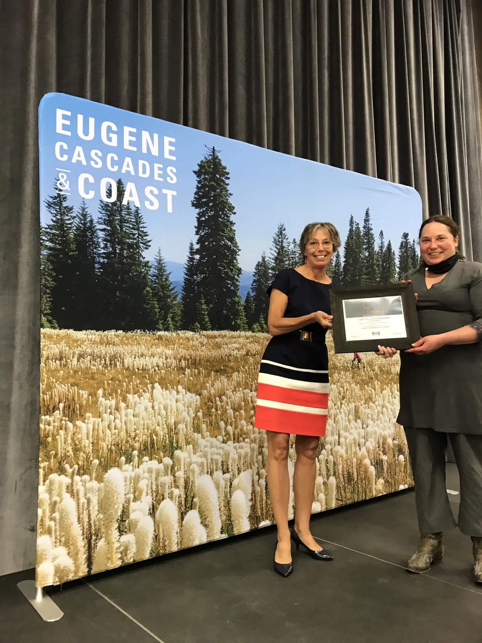 Executive Director Alice Bonasio, collects the Tourism Ambassador award on behalf of the McKenzie River Chamber of Commerce. Photo credit: Natalie Inouye